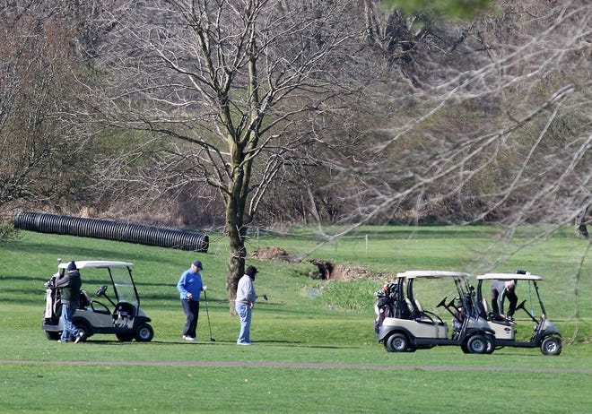 Golfers are shown on the first tee at Wilkshire Golf Course. (TimesReporter.com / Jim Cummings)