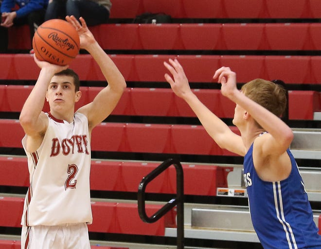 Dover's TC Molk shoots for three points over East Liverpool's Cole Dailey Tuesday night.