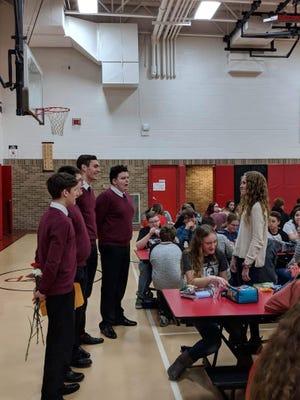 Members of New Philadelphia High School's Delphian Chorale deliver a Singing Valentine in 2019.