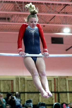 Grove City's Genavieve Kuhn competes on the bars Jan. 20 at Marysville. It was the first meet of the season for the Greyhounds, who will close the regular season Feb. 10 at Thomas Worthington.