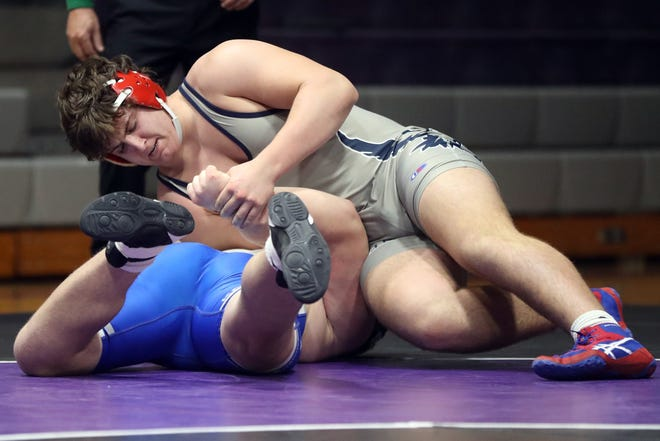 Hartley's Tony Thivener Jr., top, battles Ready's Aiden Montgomery in a  220-pound match Jan. 13. Thivner was 20-3 after helping the Hawks to a share of the title at the Newark Catholic Invitational on Jan. 23. A year ago, he was 24-17.