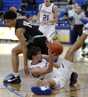 "Caleb Gossett has been a defensive and rebounding force for Olentangy, earning him praise from coach John Feasel. The 6-foot-3 senior forward has been given the nickname ""Smoke"" because ""smoke covers everything."""
