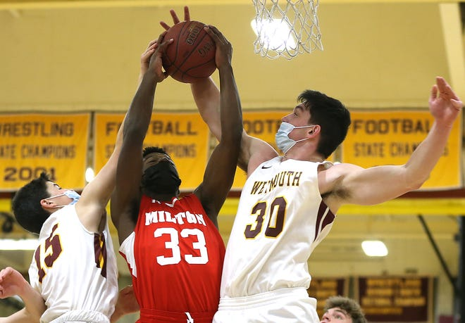 Milton's Lateef Patrick and Weymouth's Pat Doyle battle for the rebound during fourth quarter action of their game at Weymouth High on Tuesday, Jan. 26, 2021.