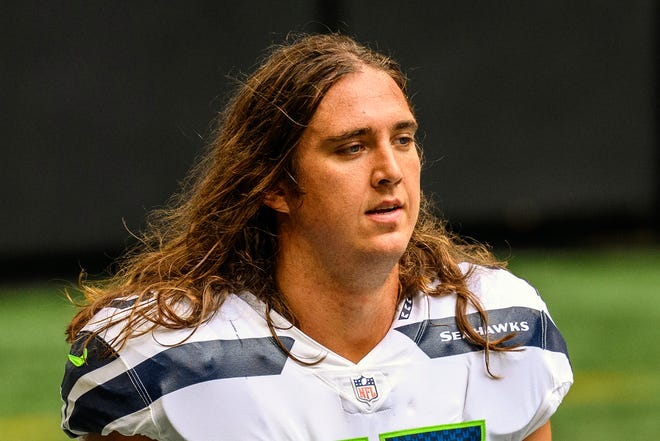 FILE - Seattle Seahawks offensive tackle Chad Wheeler (75) is shown before an NFL football game against the Atlanta Falcons in Atlanta, in this Sunday, Sept. 13, 2020, file photo. The Seattle Seahawks said Wednesday, Jan. 27, 2021, that offensive lineman Chad Wheeler is no longer a member of the team following his arrest last weekend for investigation of domestic violence. (AP Photo/Danny Karnik, File)