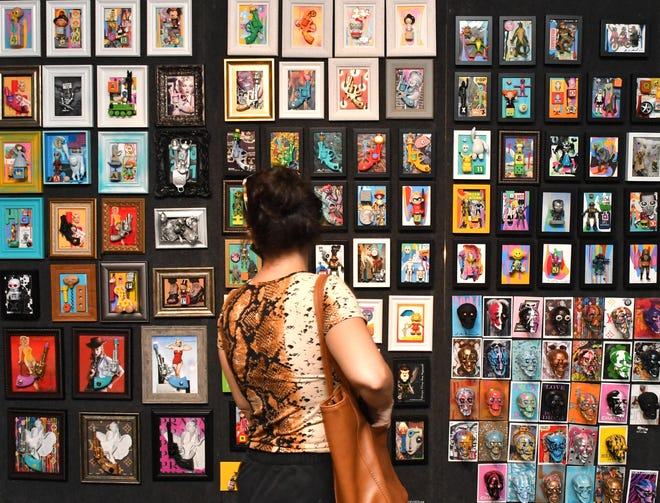 """Lina Lopez looks at the art work of """"Robot Love"""", a free immersive exhibition by over 75 artists, continues at the Foosaner Art Museum on Highland Avenue in the Eau Gallie Arts District of Melbourne until February 27, on Wednesdays through Saturdays."""