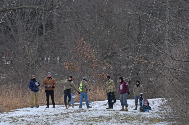 A hearty group of Frisbee-golf enthusiasts brave frigid, freezing temperatures Wednesday morning to play a round at Amann Reservoir in Galion.