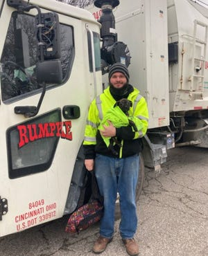 Aaron Kinsel, a Rumpke driver, rescued a puppy Wednesday morning.