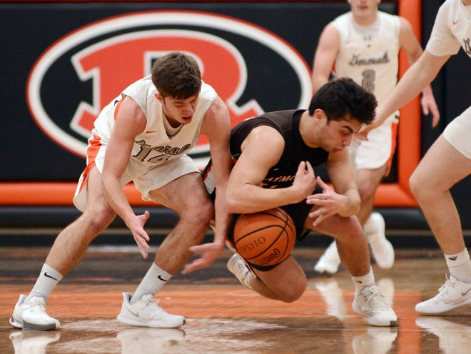 Dalton Patterson, left, fights for a loose ball with Murphy White during Ridgewood's 50-49 win against Claymont in an Inter-Valley Conference game on Jan. 26 in West Lafayette. Patterson had 13 points and 10 assists.