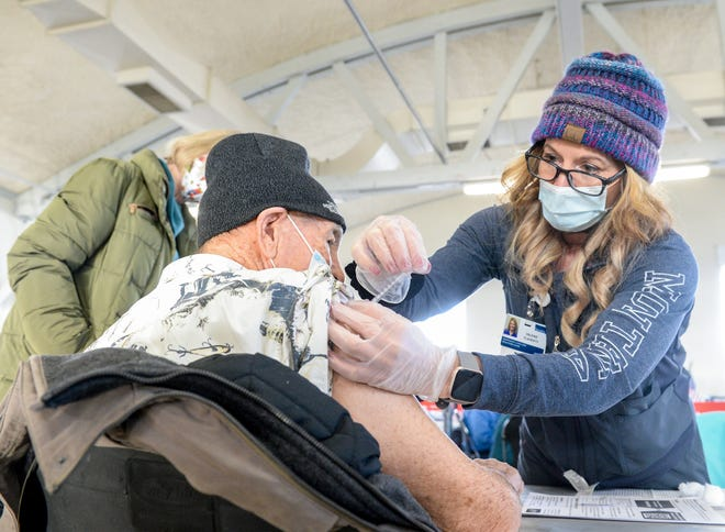 Cascade County reported zero new cases of COVID-19 on Monday. Pictured above, William Rolfe receives his COVID-19 vaccination from Valerie Flaherty, a nurse at Benefis Health System, during the COVID-19 vaccine clinic in January.