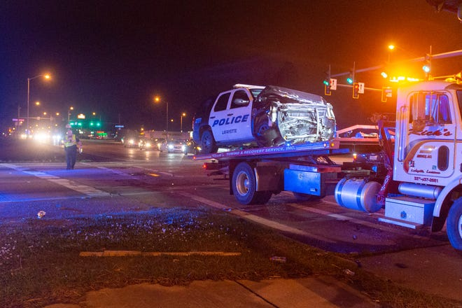 A Lafayette Police vehicle is loaded onto a tow truck after a crash at the intersection of the Evangeline thruway and Martin Luther King. Tuesday, Jan. 26, 2021.