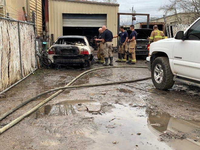 Lafayette Fire Department investigates a car fire at Slick's Garage on Salsman Street.