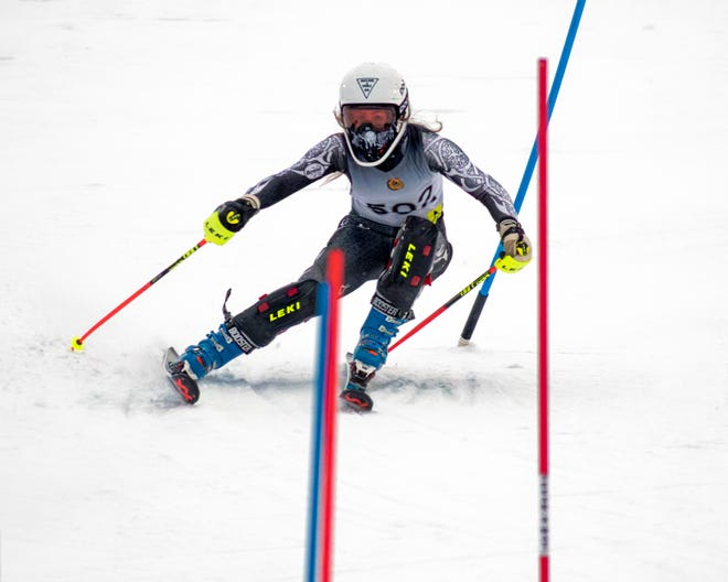 Brighton's Ellie Swanson won the first race and took third in the second in giant slalom competition Tuesday at Mt. Brighton.