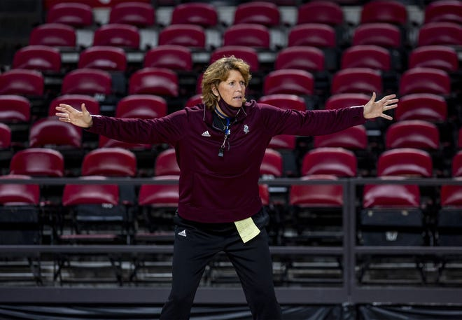Bellarmine women's head basketball coach Chancellor Dugan gestures while running her team through drills during a recent practice at Freedom Hall. Jan. 27, 2021.