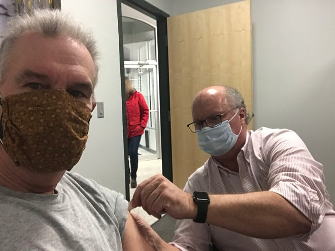 Medical reporter John Fauber gets a COVID-19 vaccine from Sage Specialty Pharmacy owner Jon Phillips.