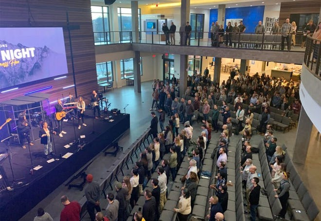 """People attend a worship service entitled """"Watch the Darkness Flee,"""" Thursday, Jan. 14, 2021, at Ramsey Solutions headquarters in Franklin, Tennessee. RNS photo by Bob Smietana"""
