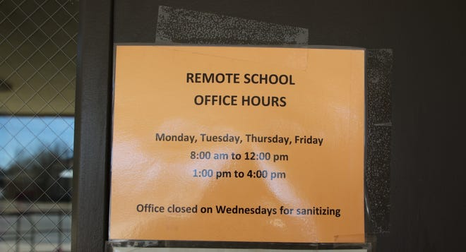 A sign at Artesia High School on Jan. 27, 2021 reminds people of office hours during COVID-19. Schools across New Mexico are making plans to get ready for the return of students on Feb. 8.