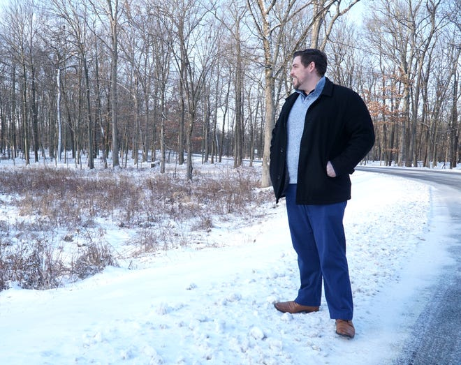 Tyler Mitchell, chief of natural resources for Huron-Clinton Metroparks, said deer culls at Kensington and Willow metroparks will improve the overall health of the deer herds and protect the parks' ecosystems. Here he pauses near Kensington's Kent Lake on Jan. 27, 2021.