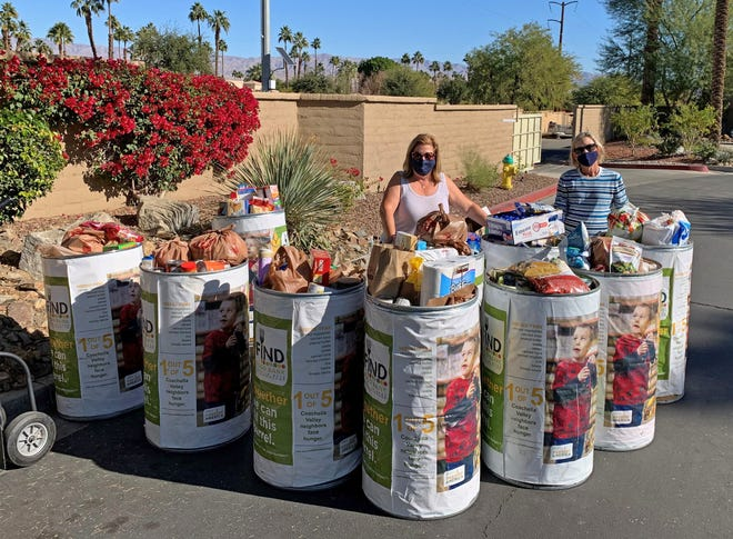 Leslie Blackburn and Debby Pascavage gathered 14 barrels of food to donate to FIND Food Bank.