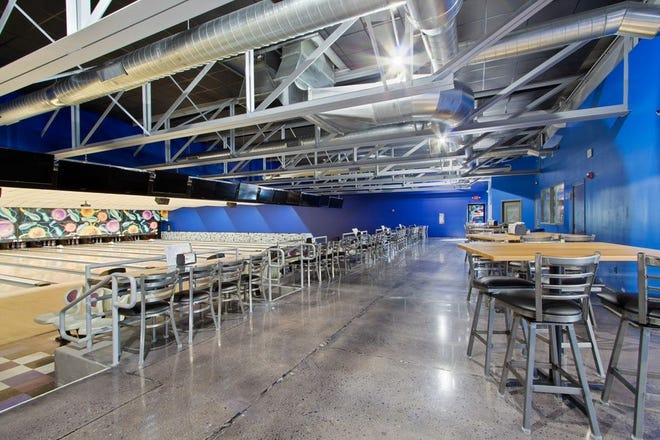 """The newly-renovated Suburban Bowlerama has a """"more modern, industrial feel,"""" according to proprietor Terry Miller"""