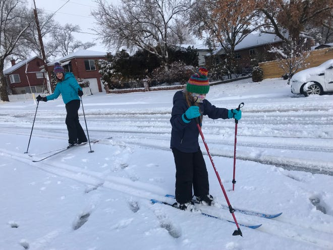 Loie Cunningham Mosher skis down Walker Avenue with her mother Cari Cunningham January 27, 2021.