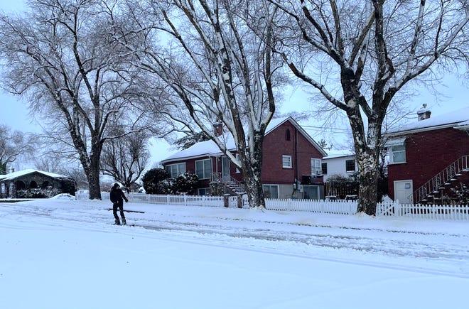 A man snowboarding down Walker Avenue in southwest Reno January 27, 2021.
