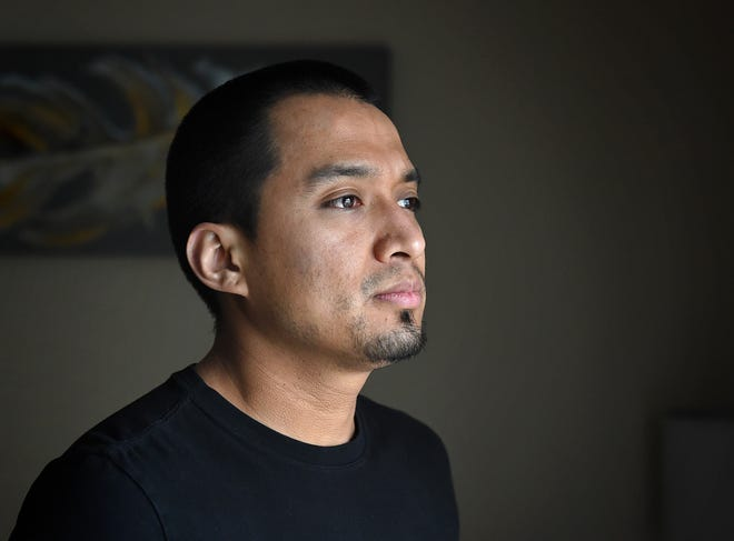 Jose Piceno stands looking out a window in his Sparks home on Jan. 26, 2021. Piceno, a DACA recipient, is a math teacher at Spark High School.