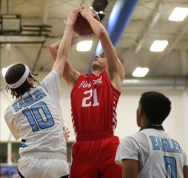 TLCA's Brycen Huffman, 10, blocks a shot attempt by Jim Ned's Ethan Eshelman during a District 6-3A game at the TLCA gym on Tuesday, Jan. 26, 2021.