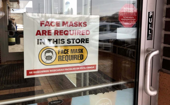 A sign at the door at Kwik Trip at Taylor Heights reminds patrons that a mask is required as seen, January 27, 2021, in Sheboygan, Wis. It is still uncertain how firms will handle masking if the mandate is no longer in force should the legislature pass the proposal.