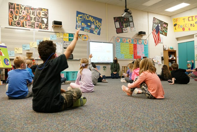Music teacher Lora Moriarty asks questions to socially distanced students Wednesday, Jan. 27, 2021, at Robert Frost Elementary in the Sioux Falls School District.
