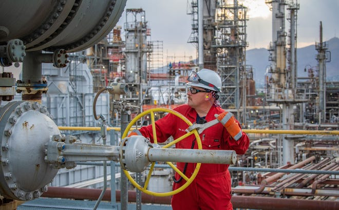 A worker inside the Marathon Petroleum Corp.'s oil refinery in East Central El Paso.