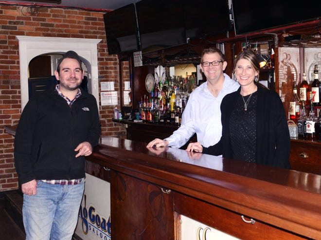 Co-owners Darren Tigner and Kristy Tigner stand with executive chef Nathan Noland, left, inside the former Smiling Goat Saloon in Zanesville. The Linden Avenue entertainment staple has closed and will reopen in the spring as La Carbra Craft Tacos, a family-friendly restaurant that will focus on scratch-made tacos and margaritas.