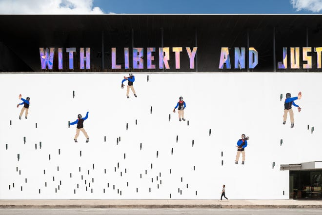 """Deborah Roberts' eye-grabbing exterior mural at the Contemporary Austin, six collages of a dancing Black boy titled """"Little Man, Little Man,"""" can be seen on the south side of the Jones Center."""