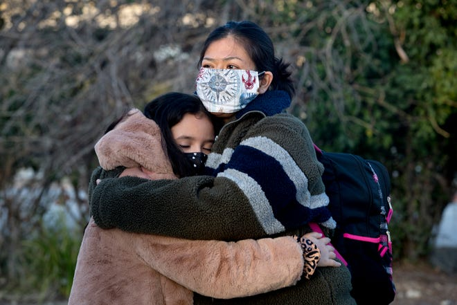 Rosa Jimenez hugs Esme Gonzalez, 10 after being release from federal prison January 27, 2021. Gonzalez became close to Jimenez while her mom, Vanessa Potkin, an Innocence Project Attorney worked to free Jimenez after 16 years in prison.