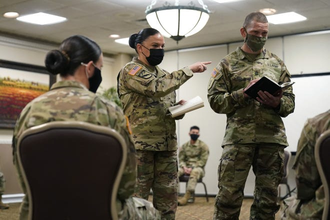 Soldiers give feedback to and Sgt. Maj. Julie Guerra, center, and Sgt. Maj. Michael Grinston, both member's of the Army's People First Task Force, about their concerns at Fort Hood Jan. 7. Following more than two dozen soldier deaths in 2020, including multiple homicides, the U.S. Army Base is facing an issue of distrust among soldiers.