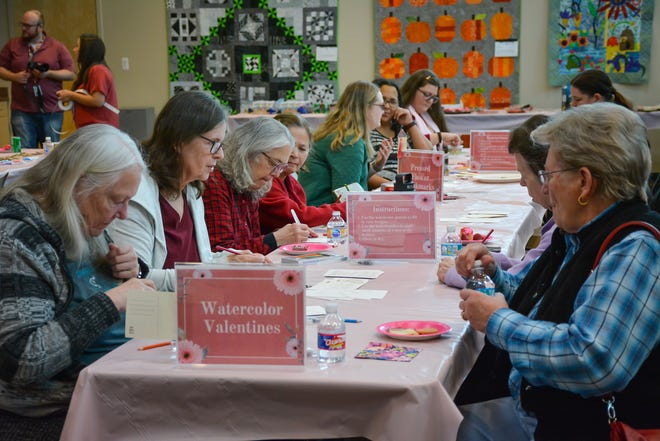 Attendees do crafts during the 12th annual Romance Readers' Social at the Pflugerville Public Library last year. The event will be virtual this year, but there will be a sun catcher craft tutorial.