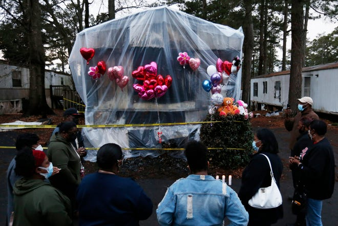 Residents gather for a memorial after three family members died in a predawn fire at Hallmark Mobile Home Park in Athens, Ga., on Wednesday, Jan. 27, 2021. (Photo/Joshua L. Jones, Athens Banner-Herald)
