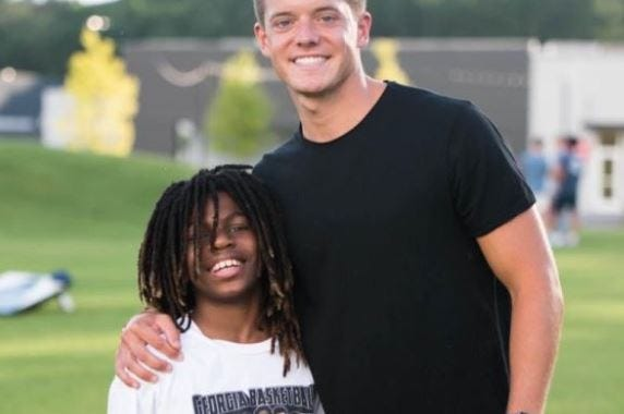 Taeden Johnson, left, and his mentor in Athens, Zac Hendrix. Hendrix has set up a fund after Taeden lost family members in a fire. [GoFundMe page photo]