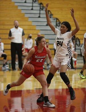 Maggie Long, left, has been a big factor in the recent success of the Wadsworth girls basketball team. [Karen Schiely/Beacon Journal]