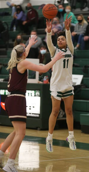 Nordonia's Madi Cluse shoots over Stow's Bella Adams during the Bulldogs' 49-46 win Wednesday night. Cluse scored 21 points and became Nordonia's all-time leading scorer in the process. [Phil Masturzo/Beacon Journal]