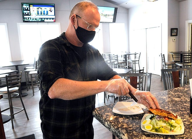 Michael Lowe puts the finishing touch on his enselada del mar at Shanks Bar and Grill. TOM E. PUSKAR/TIMES-GAZETTE.COM