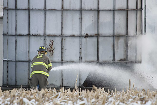 VERMILLION TWP. — Hayesville Fire Department responds Thursday morning to a silo fire. The 50-foot metal silo was being torn down and the people working on it had cut a hole in the bottom of the silo to make it fall. As they were using a metal circular saw to cut the hole, sparks caught some of old silage to start the fire. Assisting on the scene with water tankers to put out the fire were Ashland City Fire, Jeromesville Fire and Mifflin Township Ashland County. TONY ORENDER, TIMES-GAZETTE.COM
