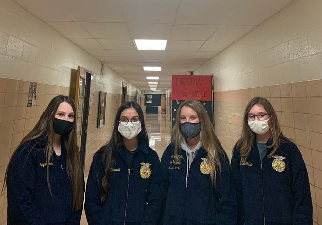 Black River FFA members with their blue jackets from the Blue Jackets program are, from left, Megan Herte, Lilly Campbell, Summer Sooy and Sarah Racut.