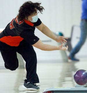 Ashland High's Parker Grissinger fires a shot during a victory over Wooster on Wednesday at Luray Lanes.