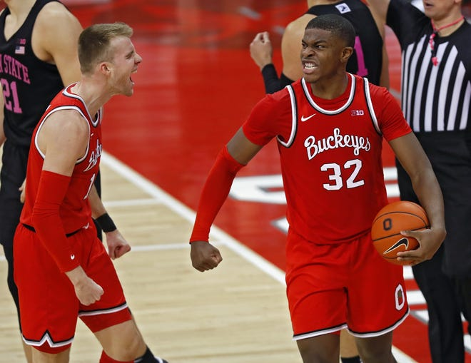 Ohio State Buckeyes forward E.J. Liddell (32) celebrates with forward Justin Ahrens (10) after getting a fouled by Penn State Nittany Lions forward John Harrar (21) after collecting a rebound on the last shot of the game during the second half of their game at Value City Arena in Columbus, Ohio on January 27, 2020.