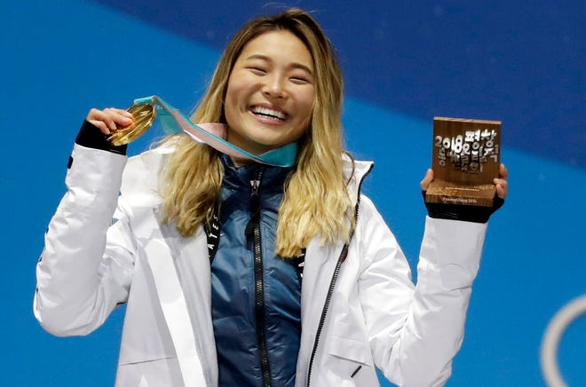 Women's halfpipe gold medalist Chloe Kim, of the United States, poses during the medals ceremony at the 2018 Winter Olympics in Pyeongchang, South Korea. Now 20 and with a year at Princeton under her belt, the Olympic champion is in the lineup for the Winter X Games, going for her fifth gold medal on the superpipe in Aspen on Saturday night.
