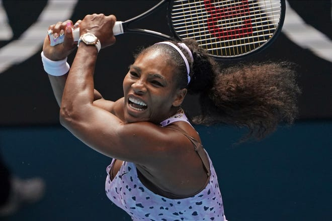 Serena Williams of the U.S. plays a shot to China's Wang Qiang at the 2020 Australian Open in Melbourne, Australia. A coronavirus-forced quarantine has mostly finished in Melbourne and Adelaide, which means most of the world's top tennis players will go from two of the quietest weeks of their lives in Australia to three of the busiest.