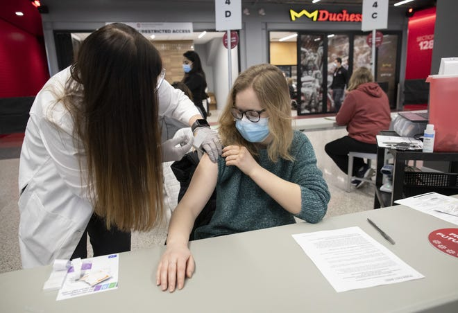 Optometry student Hanna Grabowski receives a COVID-19 vaccine from pharmacist Kristine Cline at the Schottenstein Center on Jan. 15.