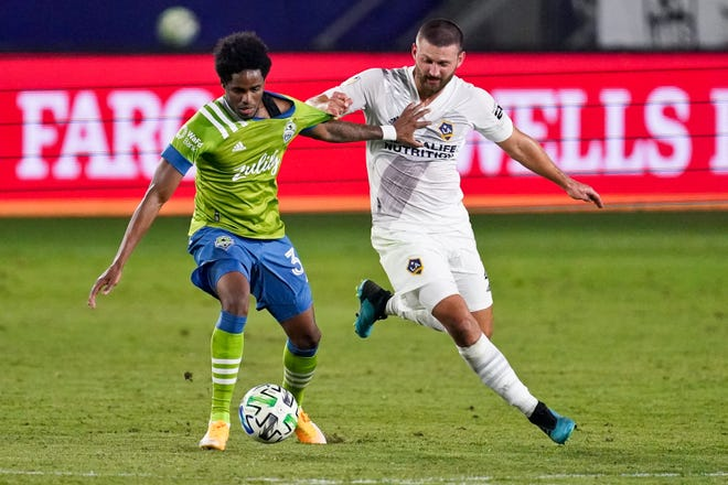 Perry Kitchen, right, battles Seattle defender Xavier Arreaga for the ball in a November game between the Sounders and the LA Galaxy.