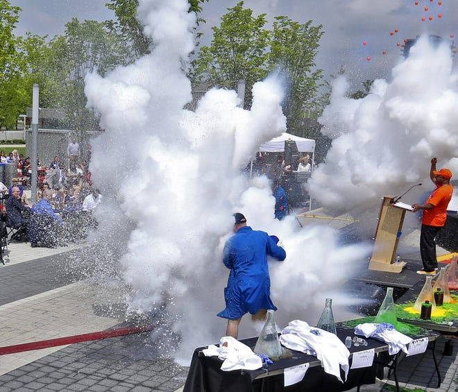 In this file photo from 2018, COSI Columbus President and CEO Frederic Bertley (orange shirt) is surrounded by explosions to announce the inaugural COSI Science Festival. This year, amid the ongoing coronavirus pandemic, the festival will happen virtually May 5-8.