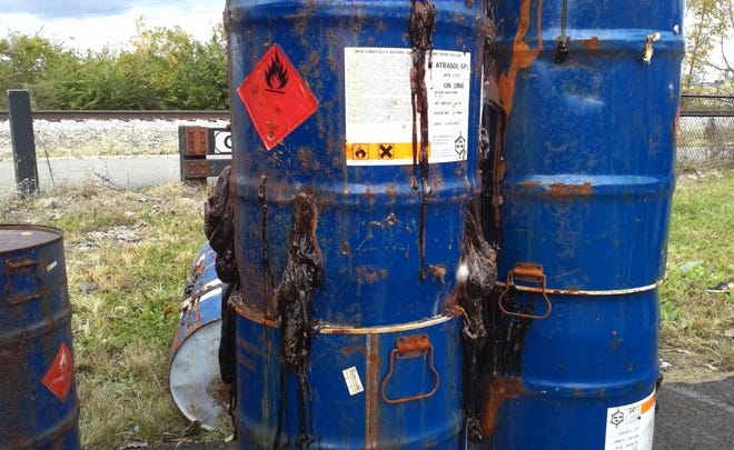 Some of the barrels of leaking hazardous chemical waste illegally disposed of by apartment complex dumpsters in the Columbus area at the direction of Khaled Ebrigit, 54, of Grove City, according to the U.S. Attorney's office.  Ebrigit was sentenced Thursday, Jan. 28, 2021 in federal court to 18 months of house arrest, ordered to pay $70,000 in cleanup costs and other costs and fines, and to perform community service that likely will entail environmental cleanup work. Photos of the leaking barrels were included in the court files for Ebrigit.